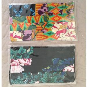 Two packaged reusable fabric face masks